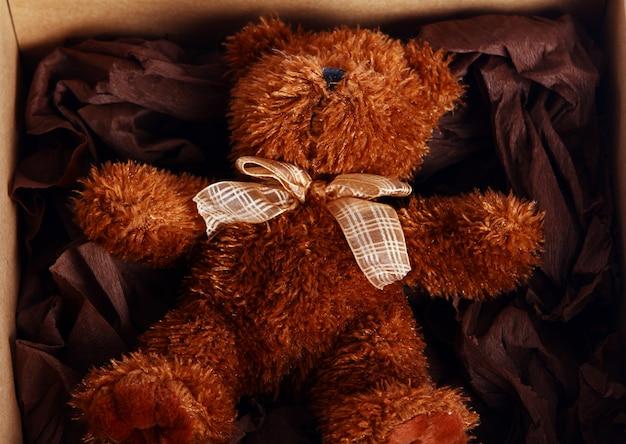 Cute teddy bear in the box Free Photo
