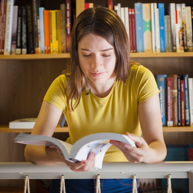 Cute Teen Girl Reading Near Railing Free Photo