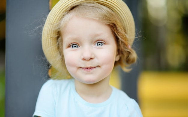 Cute toddler girl outdoors portrait in summer day Premium Photo