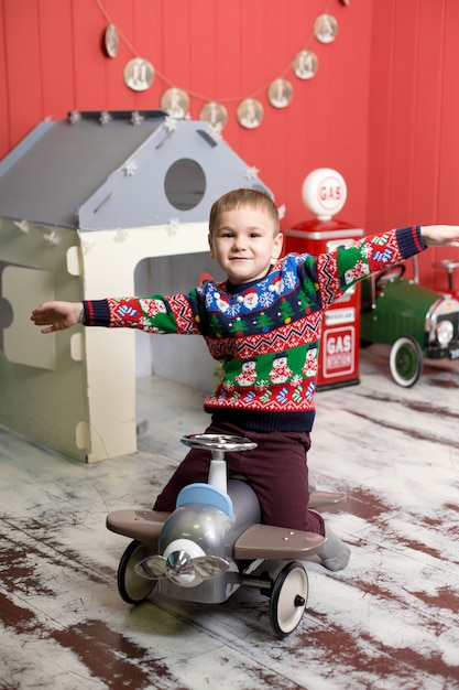 Cute toddler is playing with toy red cars Premium Photo