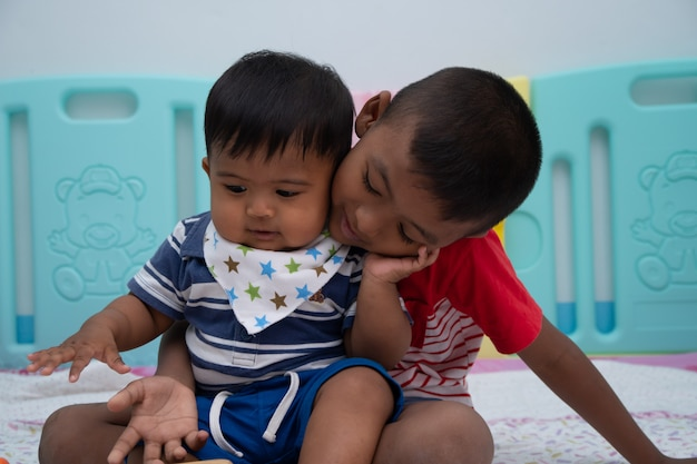 Cute two little boy play in room Premium Photo
