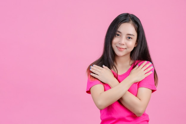Cute White Asian Woman Poses And Loves Herself On A Pink Free