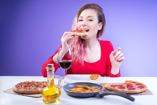 Cute woman biting a slice of pizza Free Photo