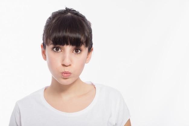 Cute woman puffing cheeks Free Photo