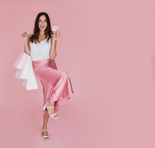 Cute woman with white sandals on pink background Free Photo
