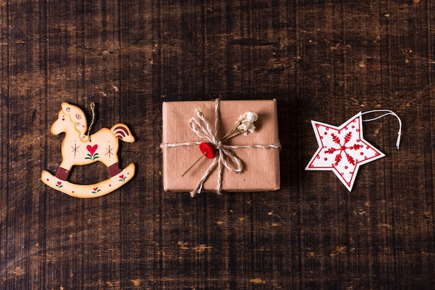 Cute wrapped gift with christmas ornaments Free Photo