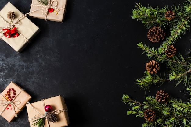 Cute wrapped gifts on black background with copy space Free Photo
