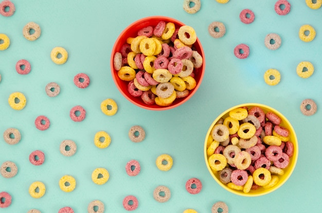 Cute yellow and red bowls on blue background Free Photo