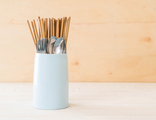 Cutlery holder chopsticks , spoon and fork Free Photo