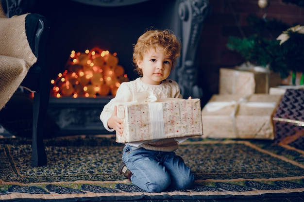 Cutte little boy at home near christmas decorations Free Photo
