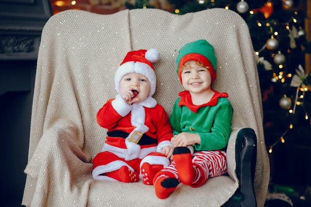 Cutte little brothers at home near christmas decorations Free Photo
