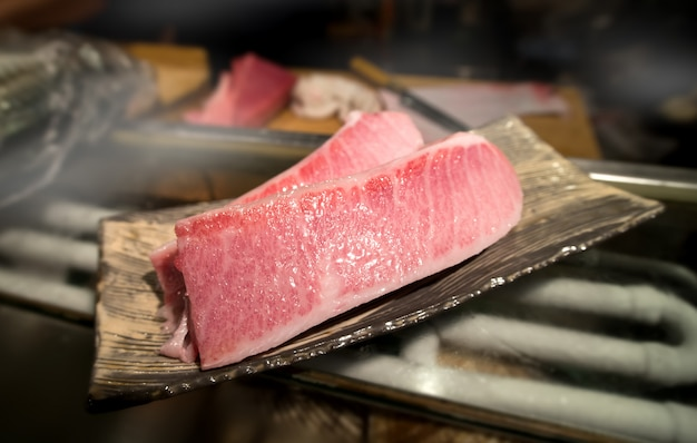 Cutting of otoro from blue fin tuna for sashimi. Premium Photo