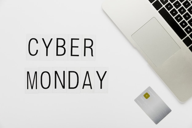 Cyber monday desk concept with card Free Photo