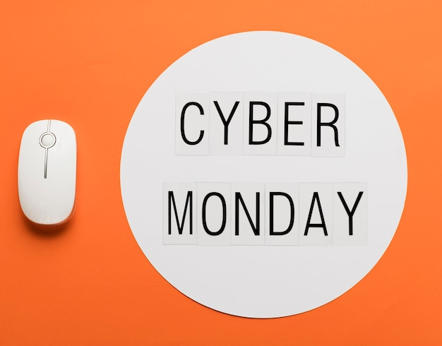 Cyber monday message with mouse Free Photo