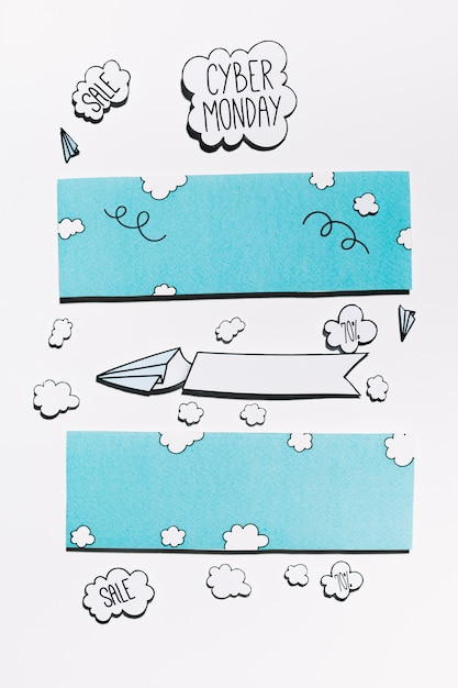 Cyber monday offer on paper cloud with planes and blue sky Free Photo