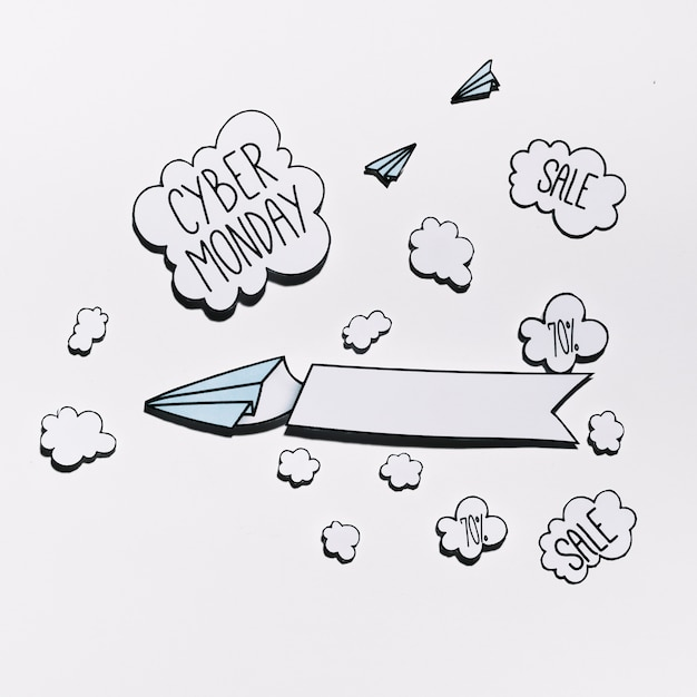 Cybermonday offer on paper cloud with planes Free Photo