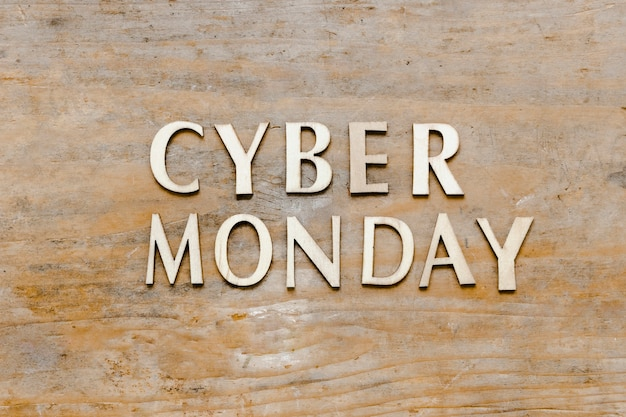 Cyber monday text on wooden background Free Photo