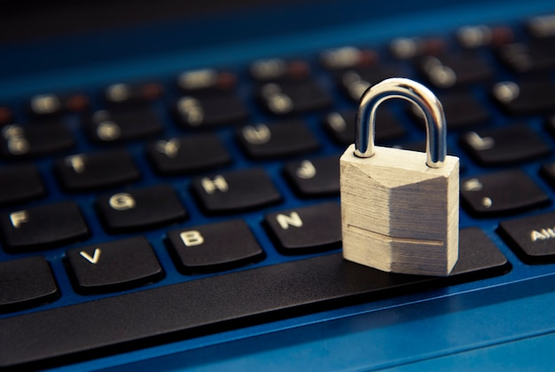 Cyber safety , padlock on laptop keyboard. internet addiction. Premium Photo