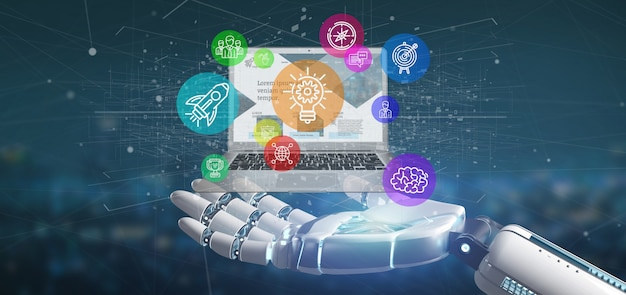Cyborg hand holding a cloud of colorful startup icon bubble with a laptop 3d rendering Premium Photo