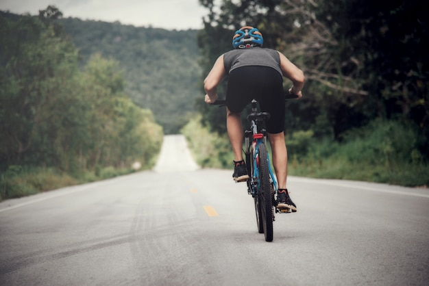 Cyclist man racing bike outdoor Free Photo