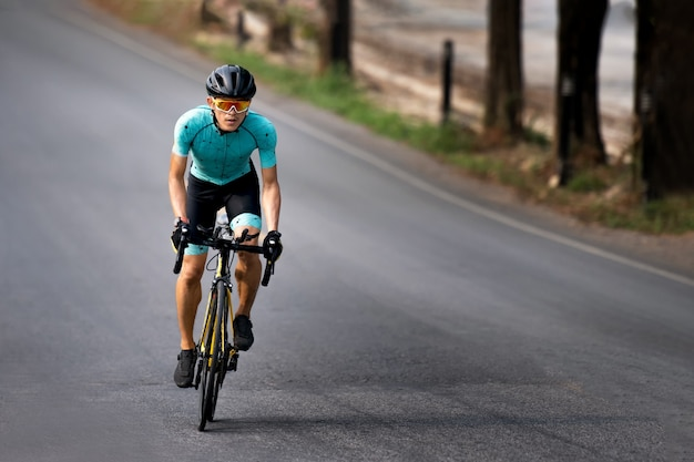 Cyclist riding a bicycle in  bike lane Premium Photo