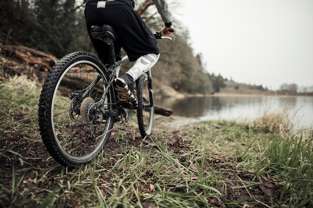 Cyclist riding bicycle near the lake Free Photo