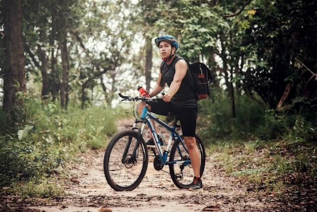 Cyclist on sunny day.bike adventure travel photo Free Photo