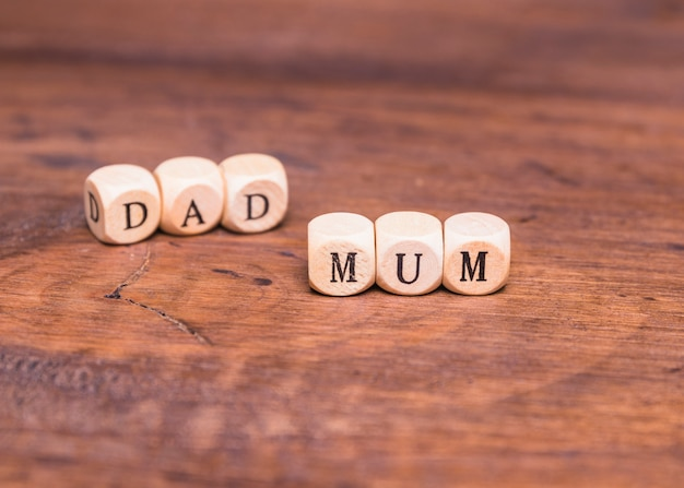 Dad and mum made with wooden dices Free Photo