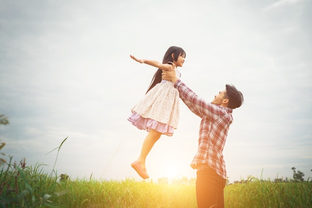 Daddy carrying his daughter with nature and sunlight, enjoyment Free Photo