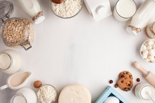 Dairy products frame on white surface Free Photo