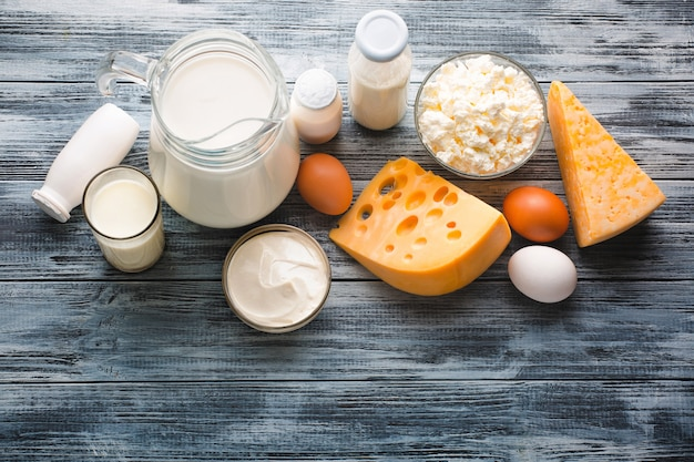 Dairy products grocery assortment on rustic wooden table Premium Photo