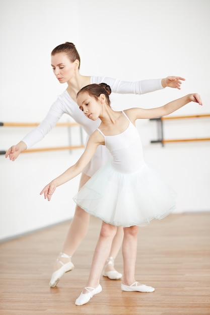 Dancing with teacher Free Photo