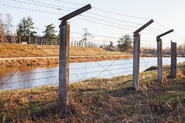 Dangerous area fenced with barbed wire fence Premium Photo