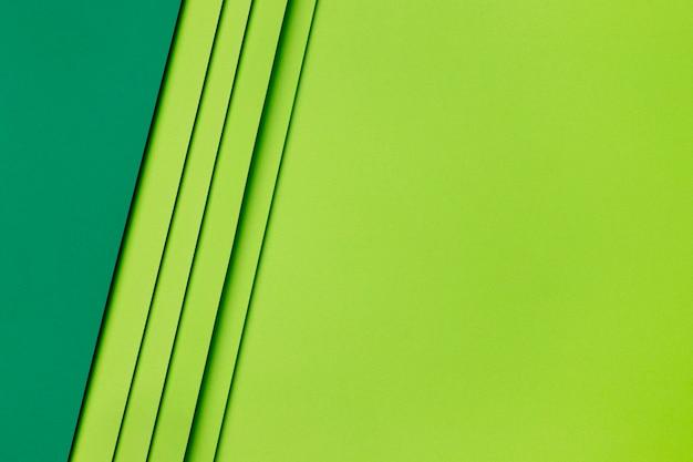 濃い緑色と薄い緑色の紙の形 Premium写真