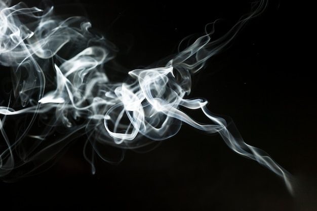 Dark background with delicate smoke effect Photo | Free Download