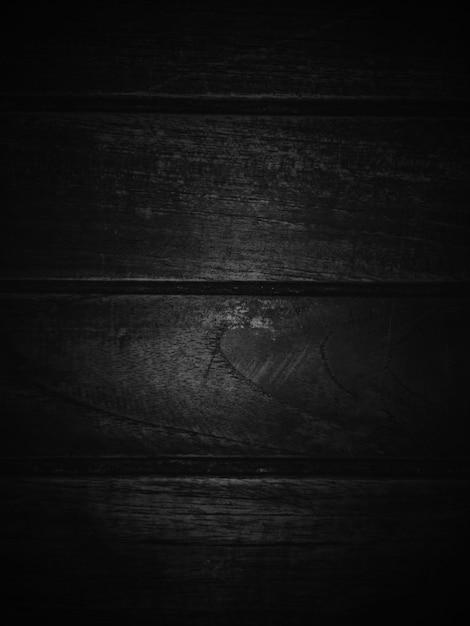 Dark black wooden texture background. Premium Photo