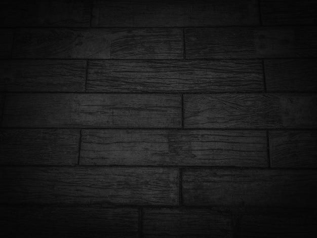 Темно-черный деревянный текстуру фона. Premium Фотографии