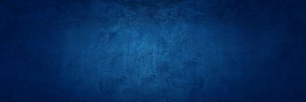 ダークブルーの質感のセメントの壁の背景 Premium写真