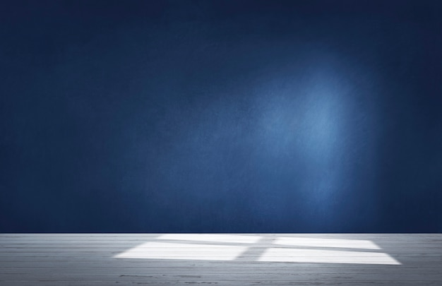 Dark blue wall in an empty room with a concrete floor Free Photo