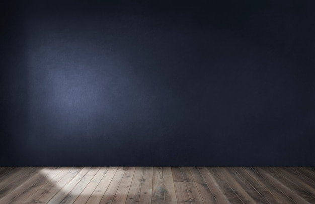 Dark blue wall in an empty room with a wooden floor Free Photo