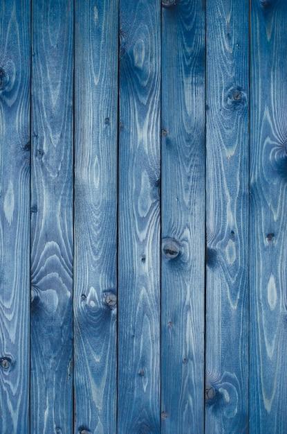 Dark blue wooden background made of a narrow board, painted in dark blue. Premium Photo