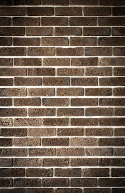 Muro di mattoni marrone scuro, back-phonon creativo, primo piano Foto Gratuite