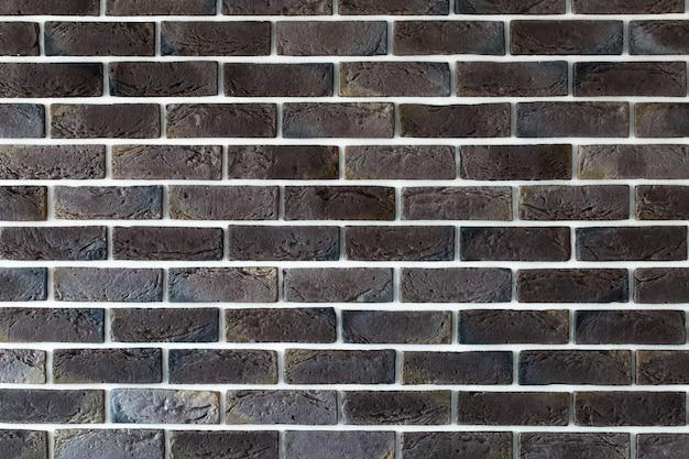 Dark brown brick wall Free Photo
