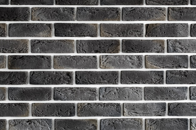 ダークブラウンのレンガの壁 無料写真