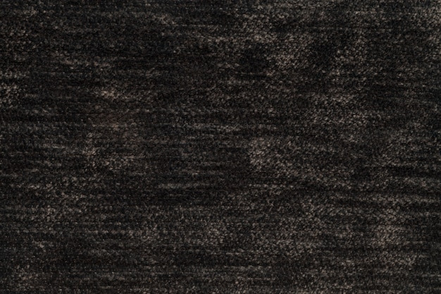 Dark brown fluffy background of soft, fleecy cloth, texture of light nappy textile Premium Photo
