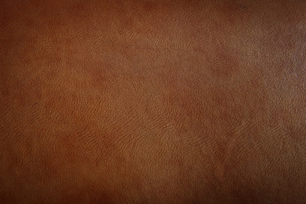 Dark brown leather texture closeup can be used as background. Premium Photo