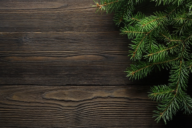 Dark brown wood table with pine beside Free Photo