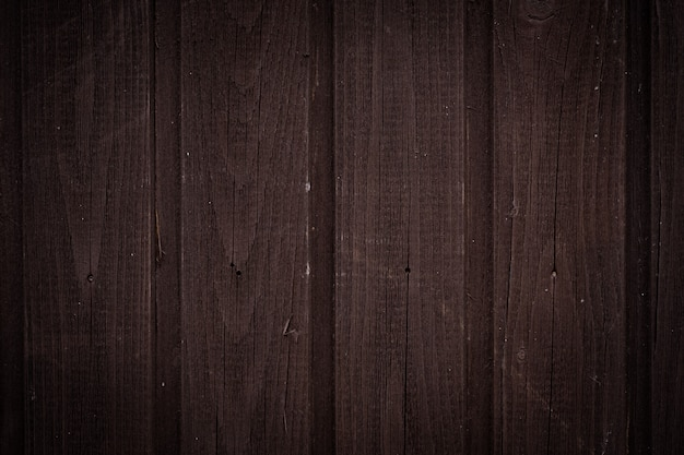 Dark brown wooden wall with vertical boards, texture for background Premium Photo