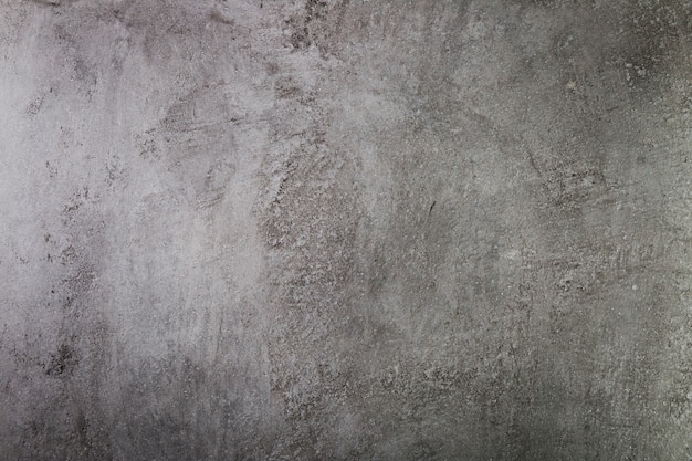 Dark cement wall with coarse surface Free Photo