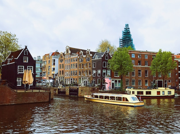 Dark clouds over canal in Amsterdam Free Photo